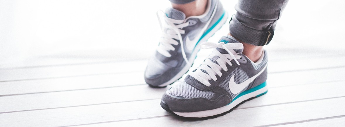 Healthy legs with grey and light blue shoes