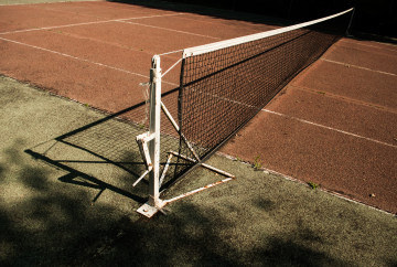 old tennis net spanning a court
